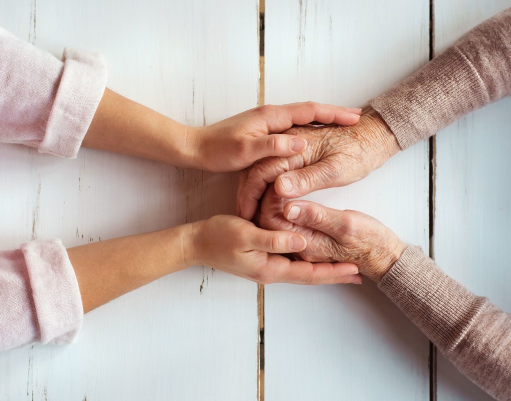 38163549 - unrecognizable grandmother and her granddaughter holding hands.