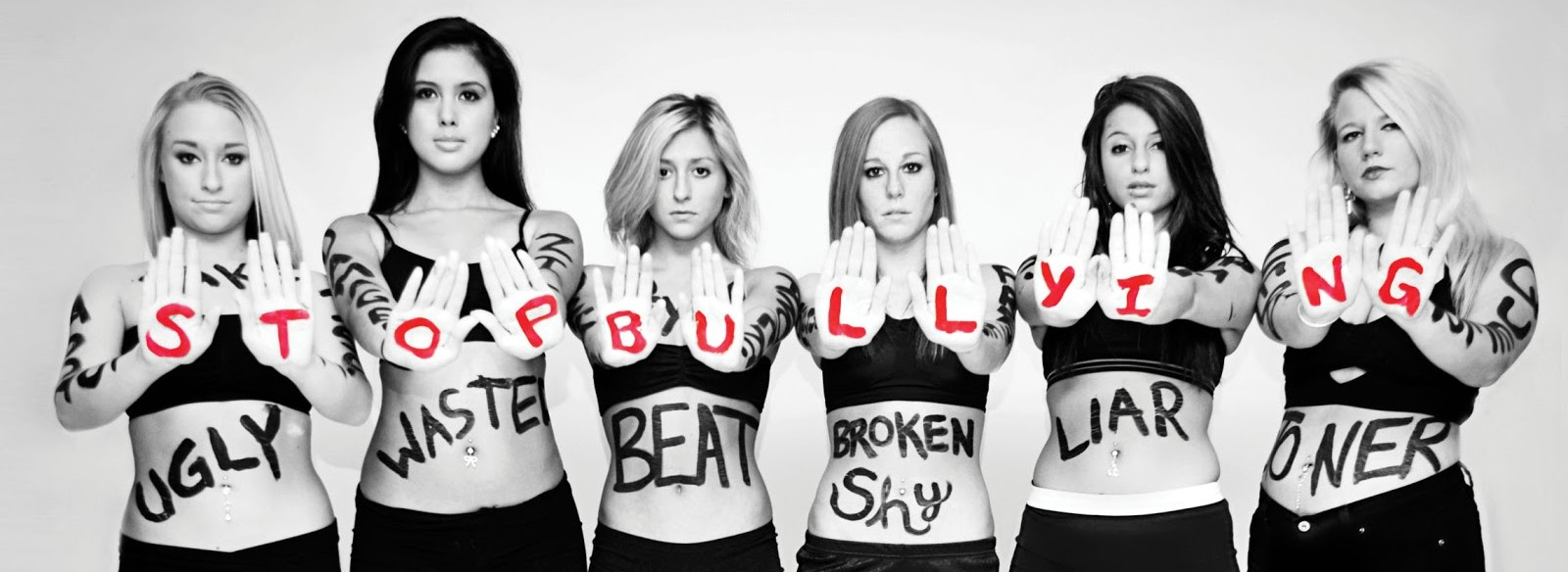 Stop-Bullying-Girls-with-words-written-all-over-bodies-Jan-12-p112-e1515259723952